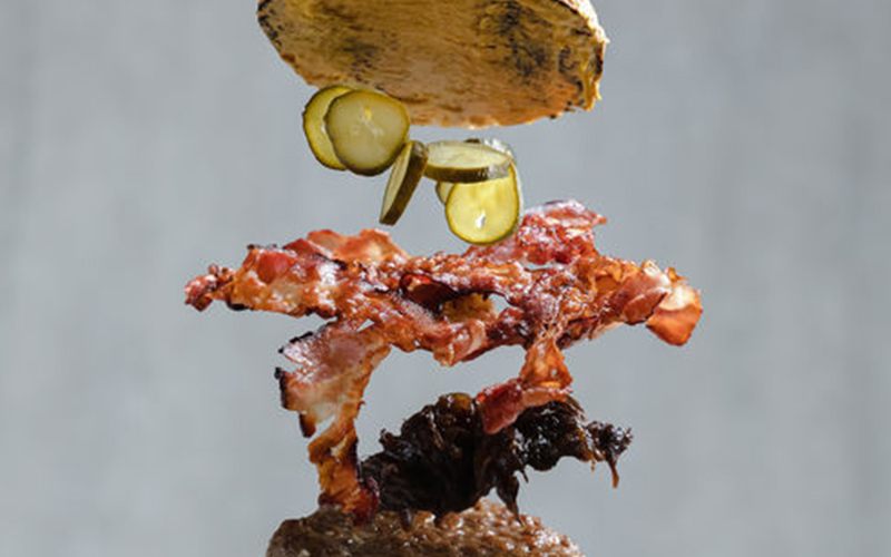 An exploded view of a hamburger