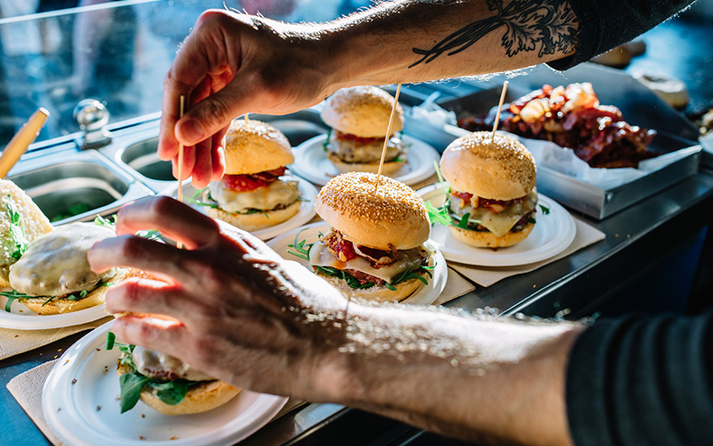 A man prepares hamburgers
